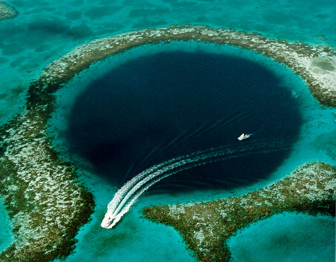 Scuba Dive Great Blue Hole Belize, Is it worth it? Scuba Diving In Belize and why YOU SHOULD ADD THIS TO YOUR BUCKET LIST. Scuba Dive Belize and the Amazing Great Blue Hole in Ambergris Caye, Belize Number 1 Tourist Attraction. #GreatBlueHole #ScubaDive #LifeExperiences #BucketList #TopScubaDestinations #BelizeDive #LoveScuba #ScubaDiversDoItDeeper #BestBelizeExperience #BackpackingBelize #CentralAmericaTravel #BackpkacBecki