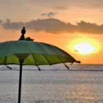 Sunset and green umbrella on Gilli T