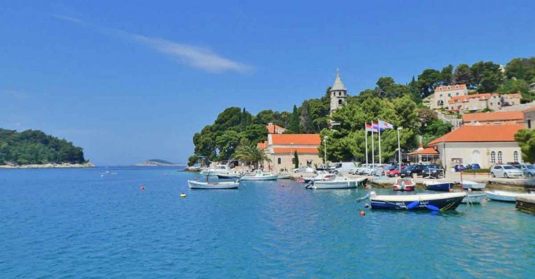 Blue sea, boats and a little bit of the peninsula at the pretty harbour of Cavtat near to Dubrovnik