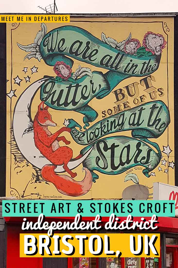 Pin for Street art in stokes croft in Bristol with an image of a mural saying 'we are all in the gutter but some of us are looking at the stars'