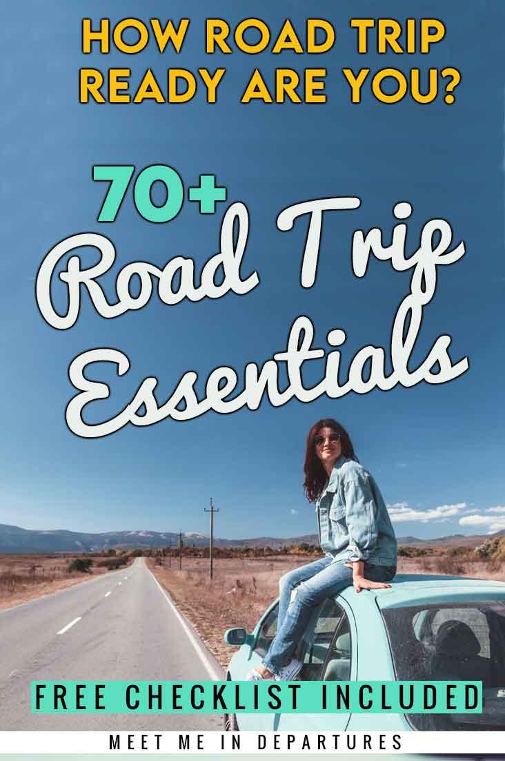 lady sitting on a car on a long empty road, road trip essentials pin